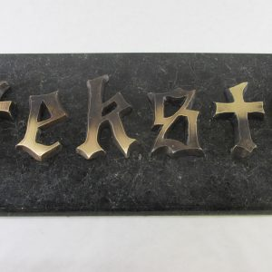 hautakivi-kirjain